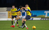 Joe Skarz of Oxford United & Daniel Leadbitter  of Bristol Rovers battle for the ball during the Sky Bet League 2 match between Oxford United and Bristol Rovers at the Kassam Stadium, Oxford, England on 17 January 2016. Photo by Andy Rowland / PRiME Media Images.