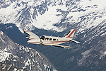 Seneca Aircraft owned by Wings of Wenatchee flying over the Washington Cascades.