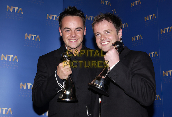 ANT McPARTLIN & DECLAN DONNELLY.10th Anniversary National Television Awards, Royal Albert Hall, London, October 26th 2004..half length trophy award Ant & Dec.Ref: FIN.www.capitalpictures.com.sales@capitalpictures.com.©Steve Finn/Capital Pictures .