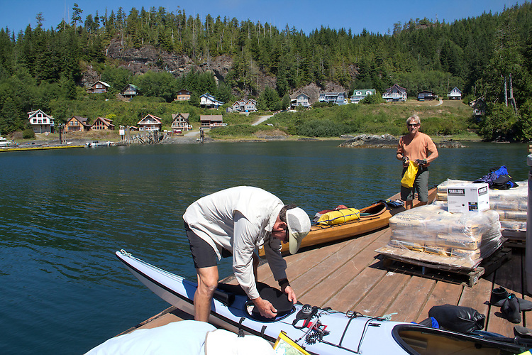 Vancouver Island, Alberni Inlet, Haggard Cove, loading kayaks for Barkley Sound, Deer Group, British Columbia, Canada,