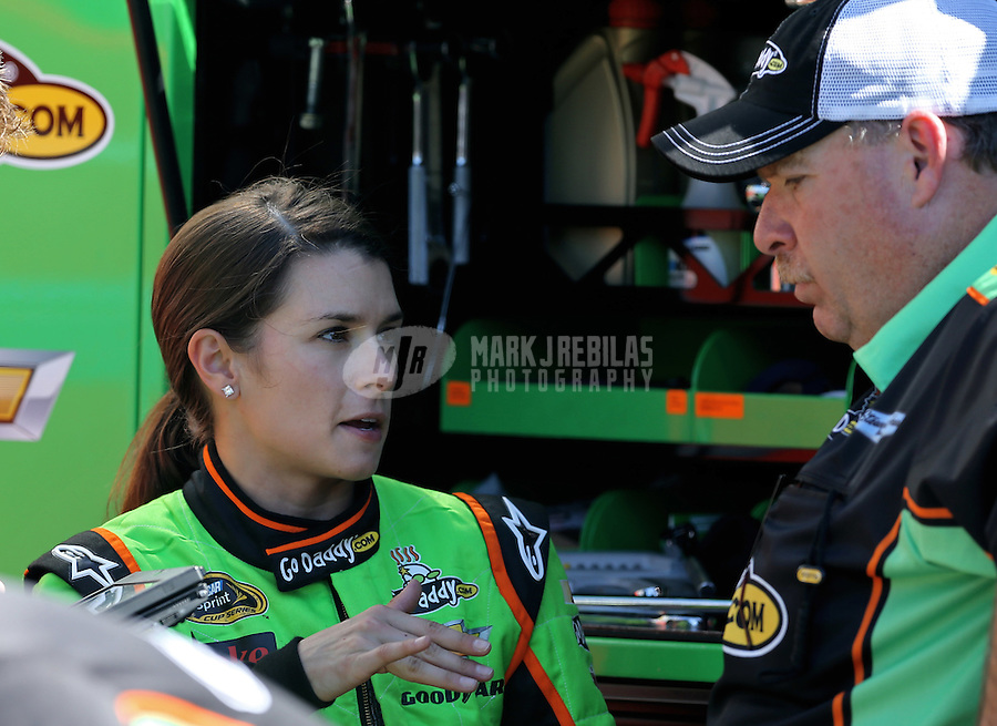 Mar. 1, 2013; Avondale, AZ, USA; NASCAR Sprint Cup Series driver Danica Patrick (left) talks to crew chief Tony Gibson during practice for the Subway Fresh Fit 500 at Phoenix International Raceway. Mandatory Credit: Mark J. Rebilas-
