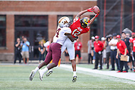 College Park, MD - September 22, 2018:  Maryland Terrapins wide receiver Taivon Jacobs (12) catches a pass during the game between Minnesota and Maryland at  Capital One Field at Maryland Stadium in College Park, MD.  (Photo by Elliott Brown/Media Images International)