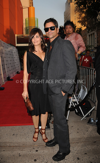 WWW.ACEPIXS.COM . . . . . ....August 17 2009, New York City....Actors Gina Gershon and John Stamos arriving at The Cinema Society & Hugo Boss screening of 'Inglourious Basterds' at the SVA Theater on August 17, 2009 in New York City.....Please byline: KRISTIN CALLAHAN - ACEPIXS.COM.. . . . . . ..Ace Pictures, Inc:  ..tel: (212) 243 8787 or (646) 769 0430..e-mail: info@acepixs.com..web: http://www.acepixs.com