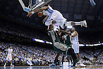 27 December 2014: North Carolina's J.P. Tokoto (above) runs into UAB's Tyler Madison (below). The University of North Carolina Tar Heels played the University of Alabama Birmingham Blazers in an NCAA Division I Men's basketball game at the Dean E. Smith Center in Chapel Hill, North Carolina. UNC won the game 89-58.