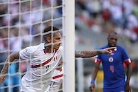Seattle, WA - Saturday June 04, 2016: Peru forward Paolo Guerrero (9)  celebrates scoring during a Copa America Centenario Group B match between Haiti (HAI) and Peru (PER) at Century Link Field.