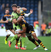 High Wycombe, England. Ben Foden of Northampton Saints tackled by Tom Varndell of Wasps during the Aviva Premiership match between Wasps and Northampton Saints at Adams Park on September 14, 2014 in High Wycombe, England.