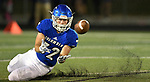 Columbia's Blake Wagner catches a pass as he slides to the turf early in the first quarter. Freeburg competed at Columbia on Friday September 29, 2018.