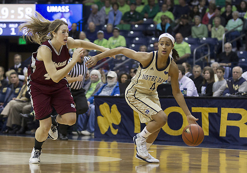 November 18, 2012:  Notre Dame guard Skylar Diggins (4) dribbles the ball as Massachusetts forward Kiara Bomben (41) defends during NCAA Women's Basketball game action between the Notre Dame Fighting Irish and the Massachusetts Minutewomen at Purcell Pavilion at the Joyce Center in South Bend, Indiana.  Notre Dame defeated Massachusetts 94-50.