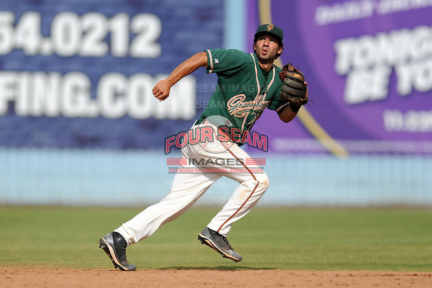 Greensboro Grasshoppers shortstop Anthony Gomez #2 during game one of a double header against the Asheville Tourists on July 2, 2013 in Asheville, North Carolina.  The Tourists won the game 5-3. (Tony Farlow/Four Seam Images)