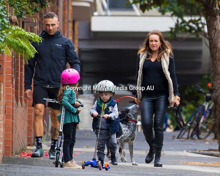 23 AUGUST 2015 SYDNEY AUSTRALIA<br /> <br /> EXCLUSIVE PICTURES<br /> <br /> Michelle Bridges with her growing baby belly pictured with her partner Steve 'Commando' Willis and his kids enjoying an afternoon walk around Potts Point. Fresh back from a holiday in Tahiti, the expectant parents were the picture of family bliss as they strolled around their local neighbourhood with the kids. Under the watchful eye of The Commando and their doting step mother Michelle the kids rode along on their scooters and had a play in the park with the dog. <br /> <br /> <br /> *No web without clearance*.<br /> <br /> MUST CALL PRIOR TO USE <br /> <br /> +61 2 9211-1088<br /> <br /> Note: All editorial images subject to the following: For editorial use only. Additional clearance required for commercial, wireless, internet or promotional use.Images may not be altered or modified. Matrix Media Group makes no representations or warranties regarding names, trademarks or logos appearing in the images.