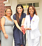 Actress Sandra Bullock cuts the ribbon at the Warren Easton Charter School Health Clinic Sunday Aug. 29th 2010 on the 5th anniversary of Hurricane Katrina. Bullock is joined by the school nurse whose dream it was to open the health clinic on right, Cassondra Ferrand, Warren Easton Charter School Nurse and the school principal  Alexina Medley to cut the ribbon at the new Health Center.BULLOCK SPEAKS ABOUT THE HEALTH CENTER AT THE EASTON SCHOOL. Photo © Suzi Altman