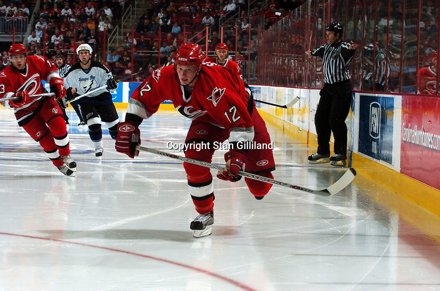 Carolina Hurricanes' Eric Staal chases a puck into the corner during a game with the Tampa Bay Lightning Sunday, Nov. 20, 2005 in Raleigh, NC.  Tampa Bay won 5-2.