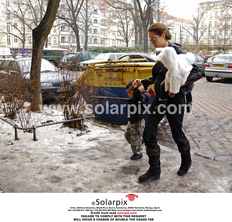 ALL ROUND PICTURES FROM SOLARPIX.COM.*MUST CREDIT SOLARPIX.COM OR DOUBLE FEE  WILL BE CHARGED*.Angelina Jolie went shopping with her Kids Maddox and Zahara at 'Prenzlauer' Berg in Berlin, Germany yesterday....DATE:02.02.06-JOB REF:2111-UTO