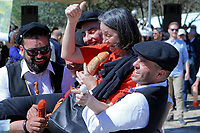 Pictured: A woman is lifted by two men during the celebrations in Tirnavos, central Greece. Monday 11 March 2019<br /> Re: Bourani (or Burani) the infamous annual carnival which dates to 1898 which takes place on the day of (Clean Monday), the first days of Lent in Tirnavos, central Greece, in which men hold phallus shaped objects as scepters in their hands.