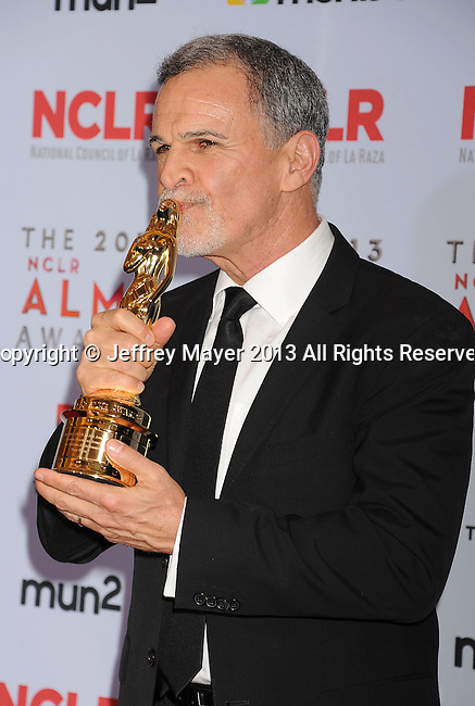 PASADENA, CA- SEPTEMBER 27: Actor Tony Plana poses in the press room at the 2013 NCLA ALMA Awards at Pasadena Civic Auditorium on September 27, 2013 in Pasadena, California.