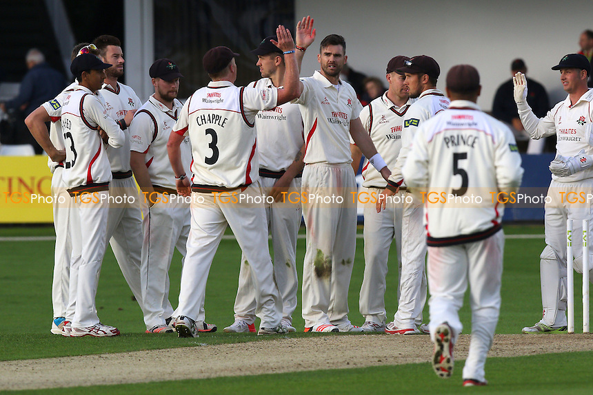 James Anderson (C) of Lancashire is congratulated by his team mates after taking the wicket of Mark Pettini during Essex CCC vs Lancashire CCC, Day Two