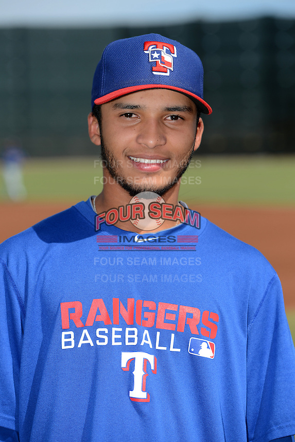 Texas Rangers pitcher Marcos Diplan poses for a photo before an Instructional League game against the Cincinnati Reds on October 7, 2013 at Goodyear Training Complex in Goodyear, Arizona.  (Mike Janes/Four Seam Images)