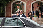 December 11, 2010. Raleigh, NC.. John Edwards, center and his daughter Cate, right,  leave the funeral of Edwards' wife, Elizabeth.. A funeral was held at the Edenton Street United Methodist Church to honor the life of Elizabeth Edwards, the estranged wife of former Democratic presidential candidate John Edwards, who died after an 6 year battle with breast cancer..