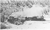 RGS #42 with freight rounding Anderson Curve on Bridge 39-A to climb Keystone Hill with a pusher on rear of train.<br /> RGS  Keystone, CO
