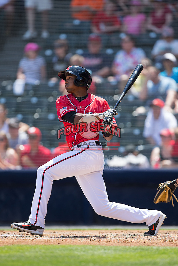 Daniel Carbonell (6) of the Richmond Flying Squirrels follows through on his swing against the Bowie Baysox at The Diamond on May 24, 2015 in Richmond, Virginia.  The Flying Squirrels defeated the Baysox 5-2.  (Brian Westerholt/Four Seam Images)