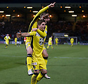 St Mirren's Kenny McLean (bottom) celebrates with Gregg Wylde after he scores their third goal from the penalty spot.