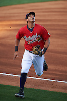 Mississippi Braves third baseman Rio Ruiz (5) tracks a pop up foul ball during a game against the Pensacola Blue Wahoos on May 28, 2015 at Trustmark Park in Pearl, Mississippi.  Mississippi defeated Pensacola 4-2.  (Mike Janes/Four Seam Images)