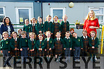 Gaelscoil Lios Tuathail: M/s Mairead Ni Chathain Ui Chonchuir  left with principal Seana Ni Chuain, right with their junior class at Gael Scioil, Lios Tuathail.
