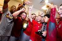 Members of the Springfield Cardinals celebrate in the clubhouse after game 4 of the Texas League Championship Series against the Frisco RoughRiders at Dr. Pepper BallPark on September 15, 2012 in Frisco, TX.  The Cardinals became the 2012 Texas League Champions after defeating the RoughRiders 2-1. (David Welker/Four Seam Images)