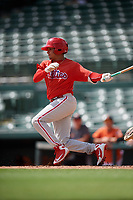 Philadelphia Phillies Nicolas Torres (18) follows through on a swing during a Florida Instructional League game against the Baltimore Orioles on October 4, 2018 at Ed Smith Stadium in Sarasota, Florida.  (Mike Janes/Four Seam Images)