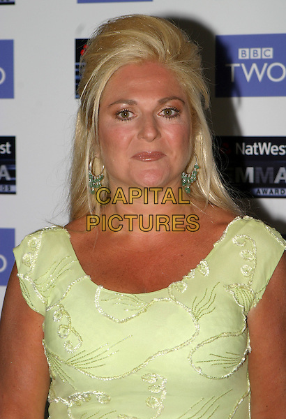 VANESSA FELTZ.2004 Emma Awards, Grosvenor House Hotel, London.May 24th, 2004.headshot, portrait, green earrings, floral print.www.capitalpictures.com.sales@capitalpictures.com.© Capital Pictures.