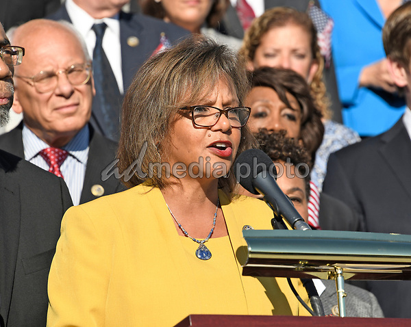 United States Representative Robin Kelly (Democrat of Illinois) makes remarks as US House Democrats appear on the East Steps of the US Capitol to make a statement against gun violence in the wake of the Las Vegas Massacre in Washington, DC on Wednesday, October 4, 2017. Photo Credit: Ron Sachs/CNP/AdMedia