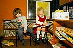 Village junior school  children reading books. Sapperton Gloucestershire 1980s