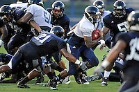 12 August 2011:  FIU's Kedrick Rhodes (9) attempts to evade Chuck Grace (21) while carrying the ball during a scrimmage held as part of the FIU 2011 Panther Preview at University Park Stadium in Miami, Florida.