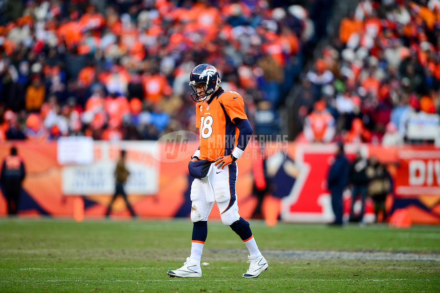 Jan 12, 2013; Denver, CO, USA; Denver Broncos quarterback Peyton Manning (18) reacts in the second quarter against the Baltimore Ravens during the AFC divisional round playoff game at Sports Authority Field.  Mandatory Credit: Mark J. Rebilas-