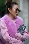 Street Style during Paris Fashion Week Spring Summer 2018 on Saturday 30th September 2017. Image shows Jessica Wang from New York. She wears a fur gilet and sweater both by MSGM, glasses by Chloe with a bag by Stee.(Photo by JSTREETSTYLE/AFLO)(Photo by JSTREETSTYLE/AFLO)