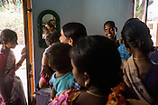 Pregnant women and mothers gather for vaccinations at the local health centre in Gorikothapally Village in Warangal district in Andhra Pradesh, India.
