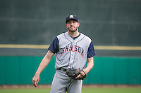 Tyler Cravy (30) of the Colorado Springs Sky Sox warms up in the outfield prior to the Pacific Coast League game against the Salt Lake Bees at Smith's Ballpark on May 22, 2015 in Salt Lake City, Utah.  (Stephen Smith/Four Seam Images)