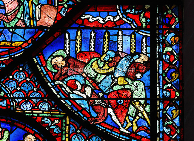 In Spain in 778, Charlemagne's knights sleep before the battle against King Aygoland and his men. Their wooden lances, which they had stuck in the ground, grow holy flowers of paradise, as a sign that they will die for the good of God. Section of the miracle of the flowering lances, from the Charlemagne window, early 13th century, in the ambulatory of Chartres Cathedral, Eure-et-Loir, France. Chartres cathedral was built 1194-1250 and is a fine example of Gothic architecture. Most of its windows date from 1205-40 although a few earlier 12th century examples are also intact. It was declared a UNESCO World Heritage Site in 1979. Picture by Manuel Cohen