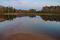 Apostle Islands National Lakeshore, WI:  Moonrise reflects in an ephemeral pond in fall at Little Sand Bay