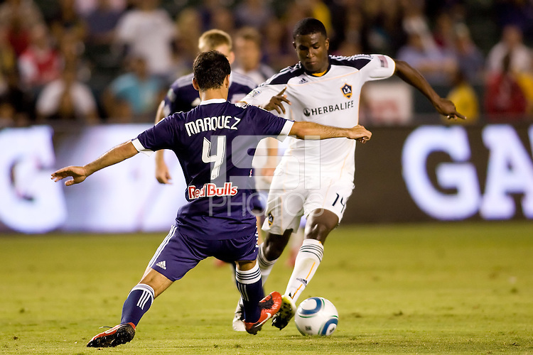 Midfielder Rafael Marquez of the New York Red Bulls moves in on LA Galaxy forward Edson Buddle. The New York Red Bulls beat the LA Galaxy 2-0 at Home Depot Center stadium in Carson, California on Friday September 24, 2010.