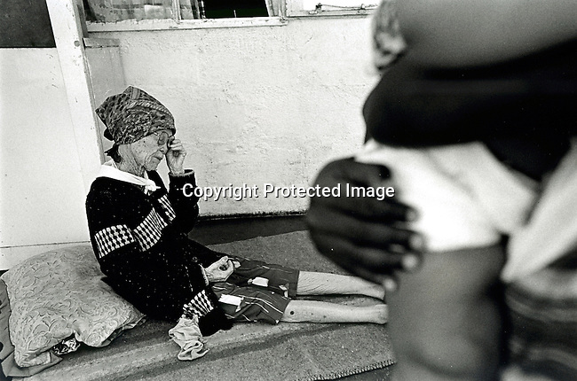 disiabu00058.Social Issues. Abuse. An 101-year old woman who suffered a brutal attemted rape by a burglar in 2001 on February 27, 2002 in Loisvale, Upington in South Africa. She managed to fight him of. In October 2001, Baby Thsepang, an 8 month old baby was brutally raped. In South Africa, some people think that having sex with a virgin or an old woman cleanses yourself from HIV/Aids. A big increase of rapes against children and elederly women has been seen the last years. About 22.000 cases of rapes of children was reported to the police during 2001..©Per-Anders Pettersson/iAfrika Photos
