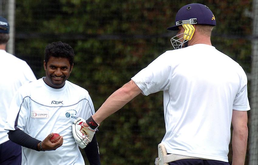 Photo: Steve Holland..Test Match Series. Australia v ICC World XI. 13/10/2005. World Training session..England's Andrew Flintoff and Muttiah Muralitharanof Sri Lanka