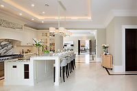 BNPS.co.uk (01202 558833)<br /> Pic: Savills/BNPS<br /> <br /> Marbled kitchen.<br /> <br /> Fairway to Heaven - Hills End has been described as 'a fabulous new masterpiece'. <br /> <br /> This breathtaking brand new mansion only a pitching wedge from one the most exclusive golf clubs in the country has emerged for sale for a whopping £22m.<br /> <br /> Hills End nestles within the prestigious Sunningdale estate in Surrey, home of the £4,000 a year Sunningdale Golf Club which dates back to 1900 and has hosted the Women's British Open and the Senior Open Championship.<br /> <br /> The newly-built property sits on a 1.75 acre plot  boasting six bedrooms, eight reception areas, a swimming pool complex with spa, sauna and yoga rooms along with a large cinema. and walk in wardrobes.<br /> <br /> The incredible Palladian style home is on the market with estate agents Savills who describe it as 'a fabulous new masterpiece'...that comes with a whopping £22 million price tag.