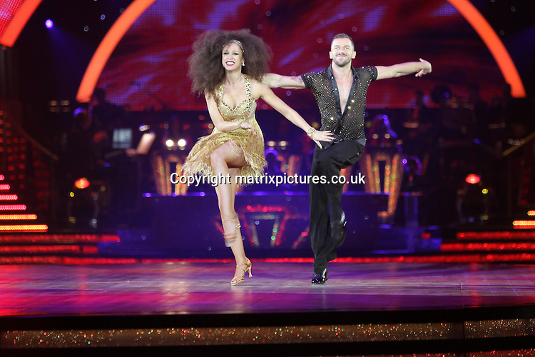 EXCLUSIVE ALL ROUND PICTURE:  TREVOR ADAMS / MATRIXPICTURES.CO.UK<br /> PLEASE CREDIT ALL USES<br /> <br /> WORLD RIGHTS<br /> <br /> English Coronation Street actress Natalie Gumede is pictured taking part in the first night of the 2014 Strictly Come Dancing Live Tour held at Wembley Arena in London, England.<br /> <br /> Joining the celebrity contestant line-up are Craig Revel Horwood, Len Goodman and Bruno Tonioli, as the tour&rsquo;s formidable judges.<br /> <br /> JANUARY 20th 2014<br /> <br /> REF: MTX 14301