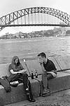 Young couple with Sydney harbour bridge. Australia.