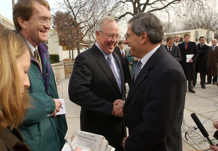 starr3/120402 -- Ken Starr joins a press conference outside the E. Barrett Prettyman Federal Courthouse, following the conclusion of mornign arguments by the RNC and other plaintiffs in the BCRA court hearing, Wednesday.