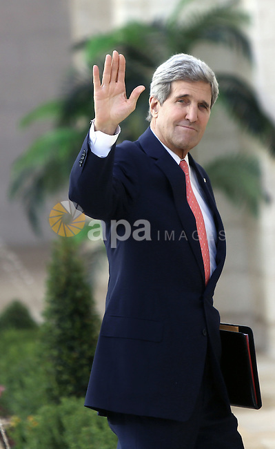 US Secretary of State John Kerry waves to media upon his arrival for a meeting with Palestinian President Mahmoud Abbas in the West Bank city of Bethlehem, 06 November 2013. Kerry began a day of meetings in Jerusalem and Bethlehem aimed at rescuing the faltering three-month-old Israeli-Palestinian peace talks. Kerry met Israeli Prime Minister Benjamin Netanyahu earlier in the day. apaimages/FADI AROURI / POOL