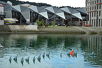 Greenpeace displays a replica of a finned shark on Wellington's waterfront to draw attention to the government's proposal to ban shark finning in New Zealand waters.The artwork was inspired by Damien Hirst's 1991 shark in a glass tank. Greenpeace has also installed 100 handmade shark fins in the nearby lagoon.The 100 floating fins last appeared in the lagoon in September when Greenpeace was urging the government take action on shark finning. Now Greenpeace is encouraging people to send a message to the government supporting the proposed ban and asking for it to be immediate. The deadline for public submissions is Sunday, December 8. Photo: Dave Lintott / lintottphoto.co.nz