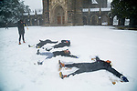 Members of the Duke Women's Swimming & Diving team make snow angels in front of Duke Chapel during a January snowfall of several inches.