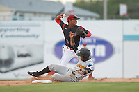 Batavia Muckdogs shortstop Marcos Rivera (8) attempts to turn a double play as Raul Siri (55) slides into second base during a game against the West Virginia Black Bears on June 24, 2017 at Dwyer Stadium in Batavia, New York.  The game was suspended in the bottom of the third inning and completed on June 25th with West Virginia defeating Batavia 6-4.  (Mike Janes/Four Seam Images)